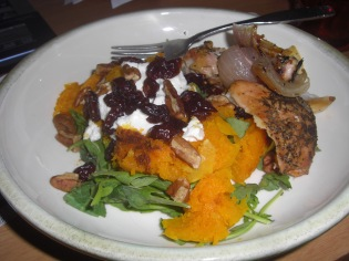 Spinach salad with chicken, goat cheese, acorn squash, dried cranberries, pecans.