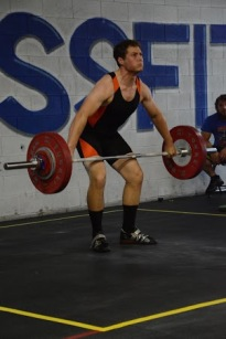 Bryce mid-snatch with 90kg at the Old Dominion Classic