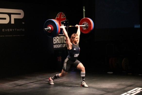 Rebeka Tiler (-69kg) of GBR jerking 115kg at 15 years old